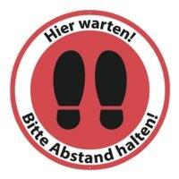 Bodenaufkleber »Hier warten! Bitte Abstand halten! Schuhsohlen« rund Innenbereich Ø:30 cm rot / weiß