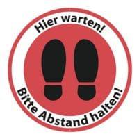 Bodenaufkleber »Hier warten! Bitte Abstand halten! Schuhsohlen« rund Innenbereich Ø:50 cm rot / weiß